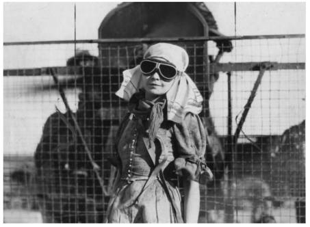 Lillian Gish wearing pilot goggles and bandana to protect herself against the sand - The Wind