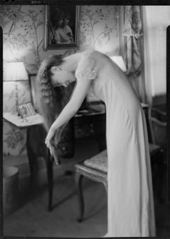 Nell Dorr (1893-1988); [Lillian Gish standing and brushing her hair]; nitrate negative; Amon Carter Museum of American Art; Fort Worth TX; P1990.47.3506